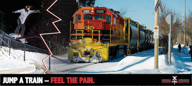 Snowboarders jump a train feel the pain